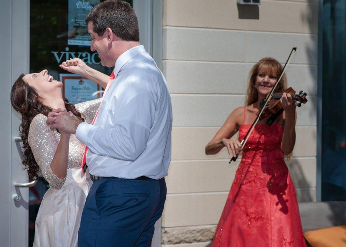 Christine Playing for happy couple
