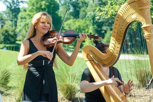 Christine playing violin with harpist
