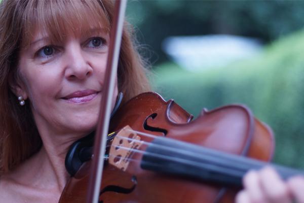 Christine playing violin closeup